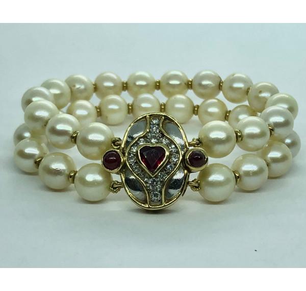 Pulsera de Perlas,  oro amarillo, diamantes y rubis